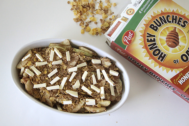 apples covered with cereal and slice butter, with box of Honey Bunches of Oats