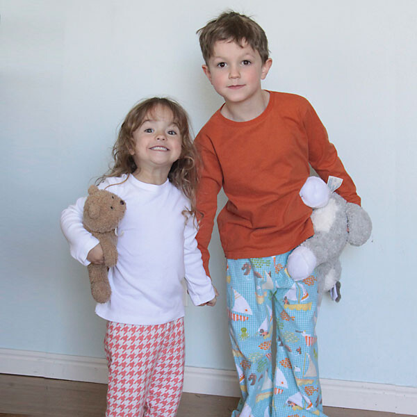 A little girl and girl wearing homemade pajamas