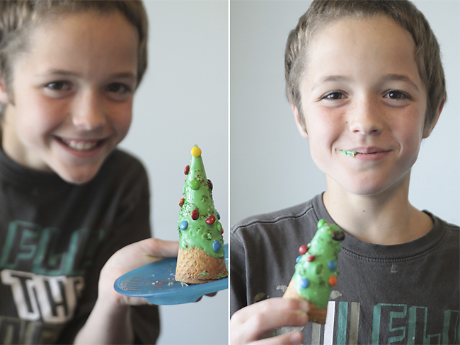 A young boy eating a Christmas tree ice cream cone