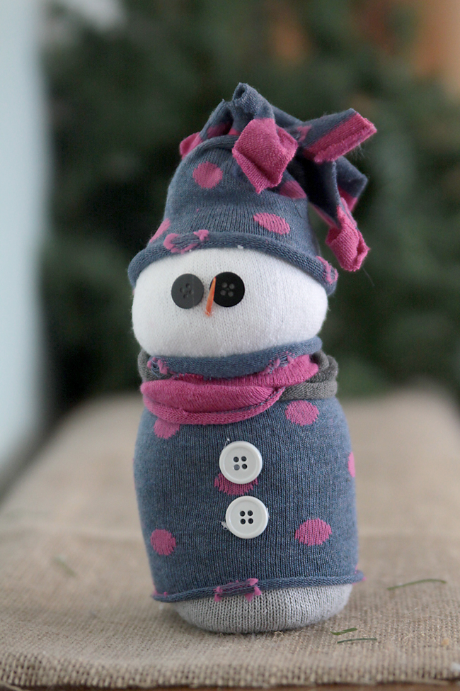 snowman made from sock filled with rice with sweater and hat made from another sock