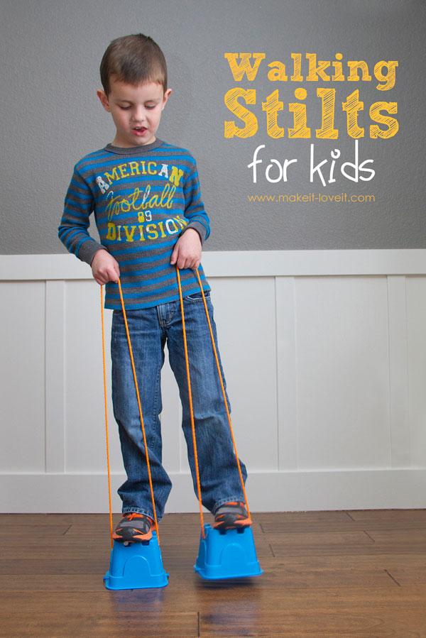 A little boy that is standing on DIY stilts