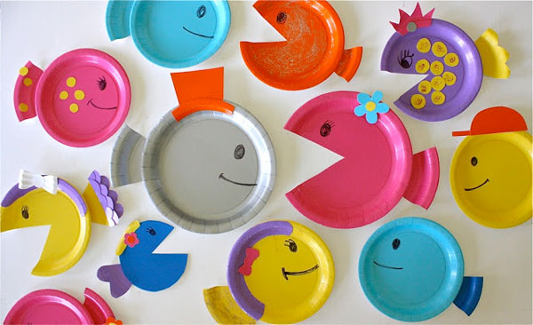 Paper plates cut and decorated to look like fish
