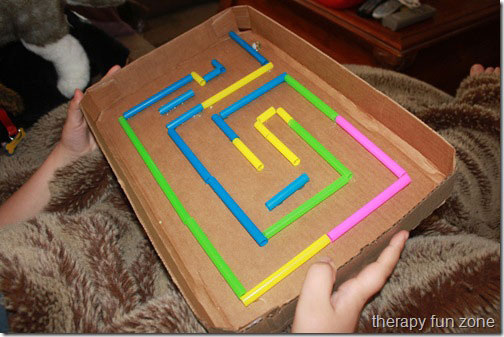 Fun kid activity maze made from a cardboard box lid and straws