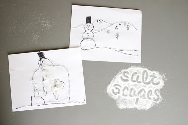 Papers decorated with salt to look like snowy landscapes