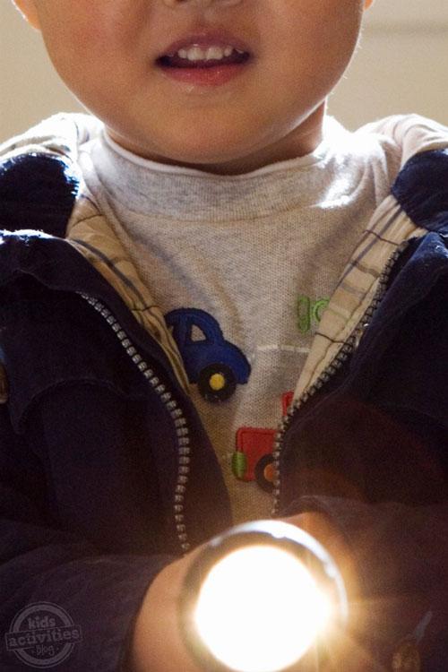 Little boy holding a flashlight