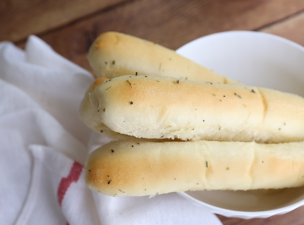 This copycat recipe for Olive Garden breadsticks is even better than the original! These soft garlic breadsticks are absolute heaven.