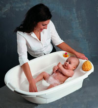 Woman with Baby in a small tub