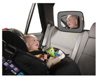 Mirror placed in a car so baby in carseat can look it in