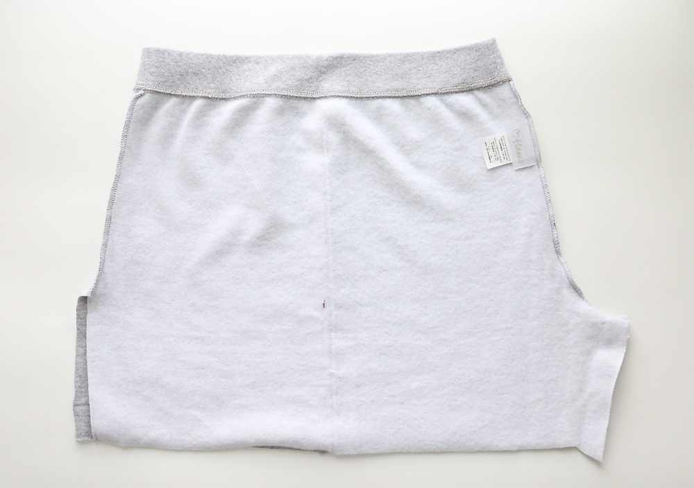Cut off sweatpants turned inside out with inside seams undone