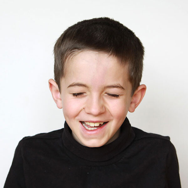 A young boy who is laughing