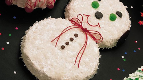 Easy birthday cake decorated to look like a snowman