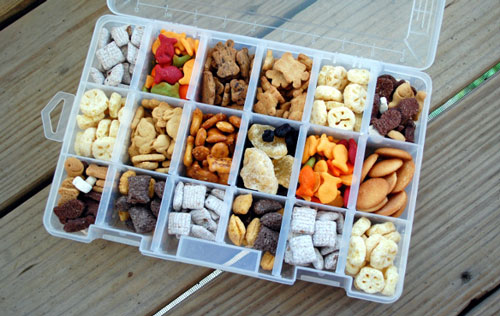 A divided snack container box filled with different types of food for a road trip