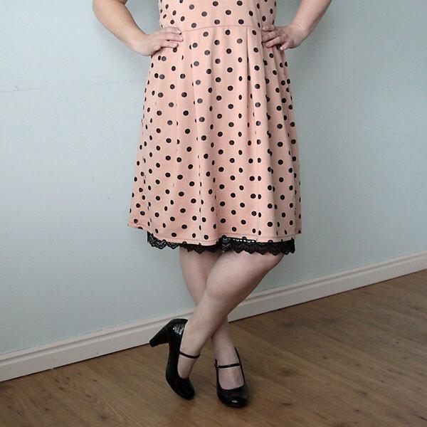 A woman wearing polka dot dress