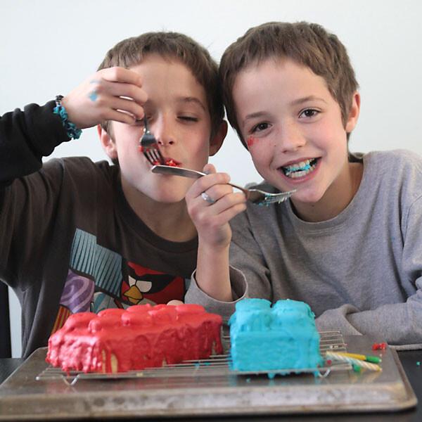 little boys eating birthday cake