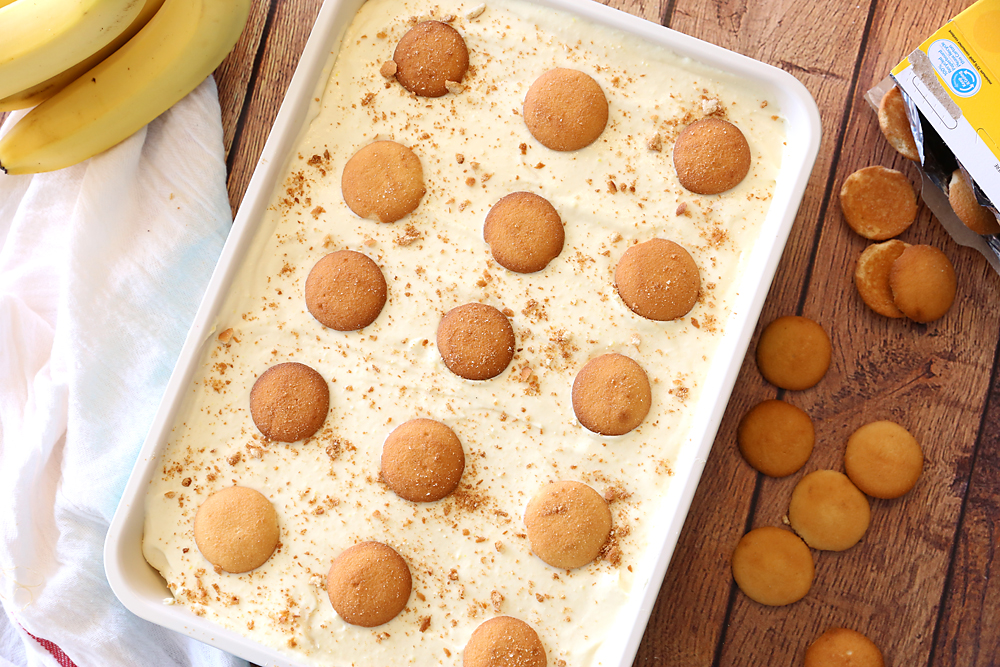 Banana pudding in a 9x13 pan with vanilla wafers on top