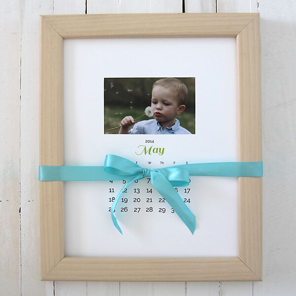 Photo calendar in a frame with a ribbon tied around it