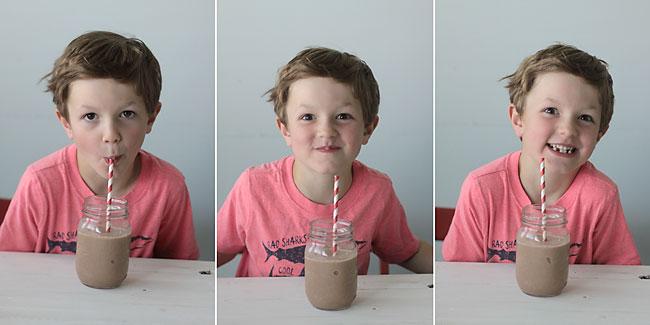 boy drinking a chocolate breakfast smoothie