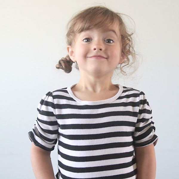 A young girl in a striped shirt