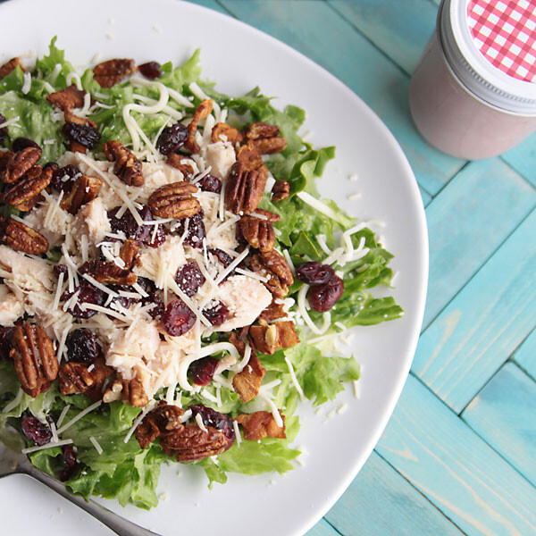 sweet sensation salad with chicken, nuts, cheese, and craisins on a plate
