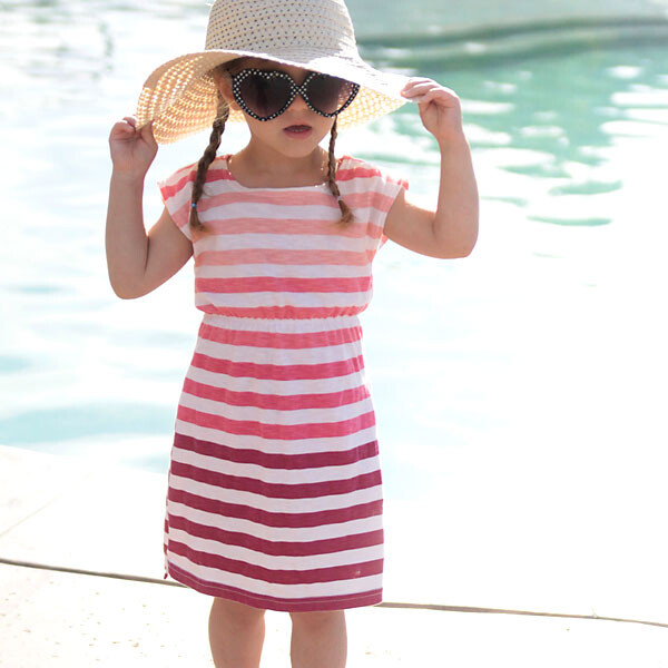 A woman in a sunhat and sunglasses wearing a DIY swimsuit coverup