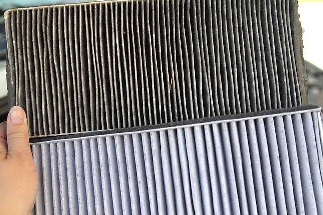 A dirty car air filter and a clean one