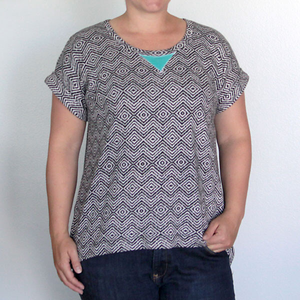 A woman wearing a t-shirt with cuffed sleeves