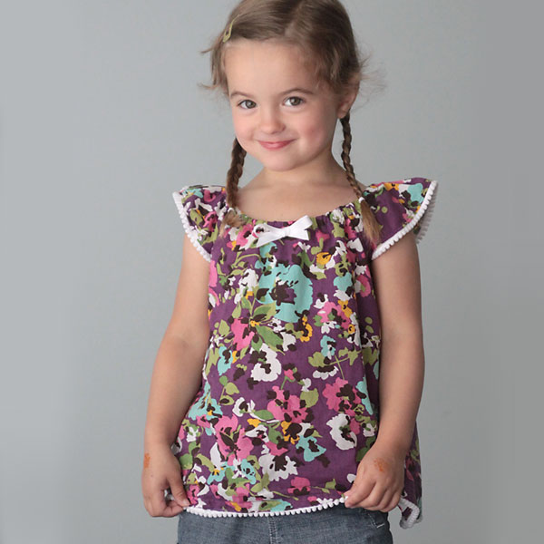 A young girl in a flutter sleeve top made from a free sewing pattern