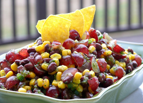 A bowl with bean and grape salsa