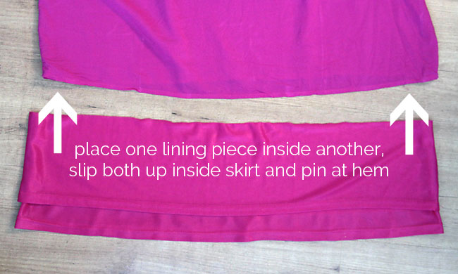 Lining pieces pinned inside dress hem