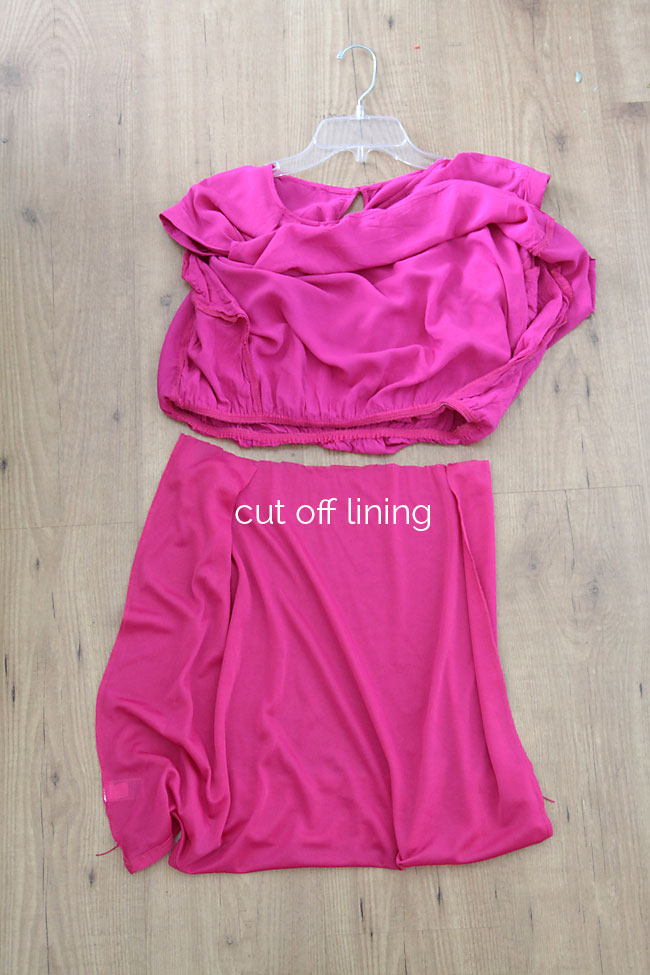 Cutting off the lining of a pink dress