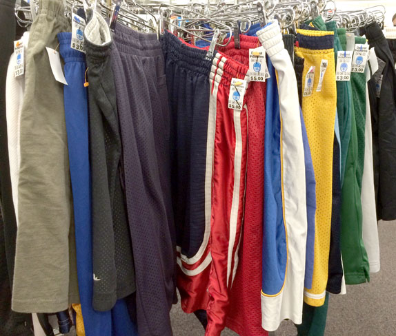 A rack of sweatpants at a thrift store