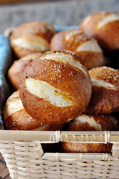 A basket full pretzel rolls