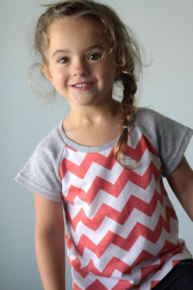 Girl wearing a raglan sleeve t-shirt