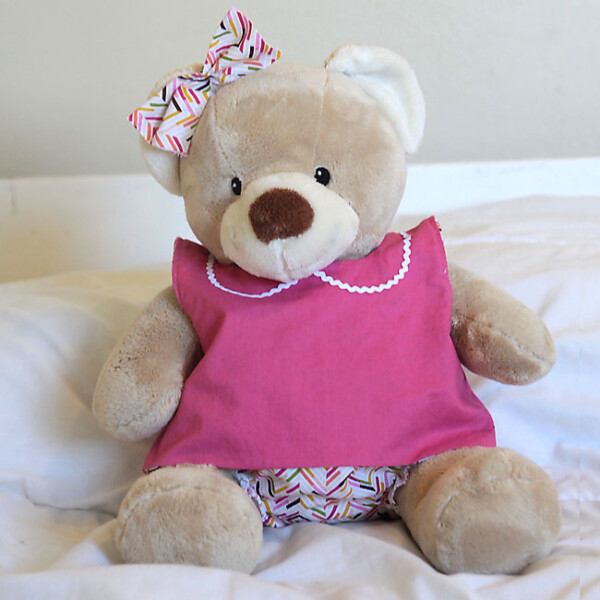 A teddy bear wearing clothes made from a free sewing pattern