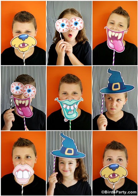 kids using halloween photo props for funny photos