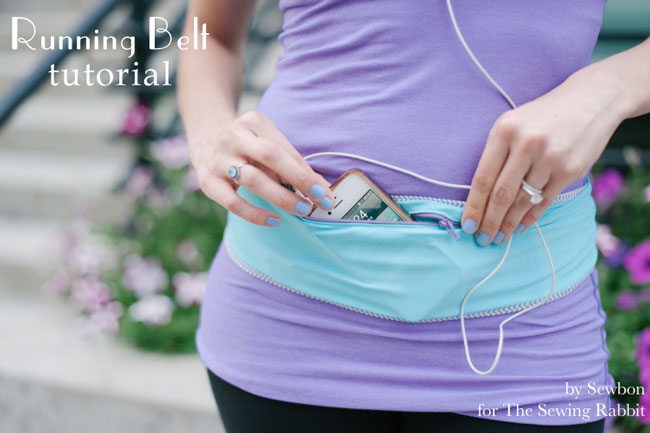 woman wearing a running belt with her phone in it