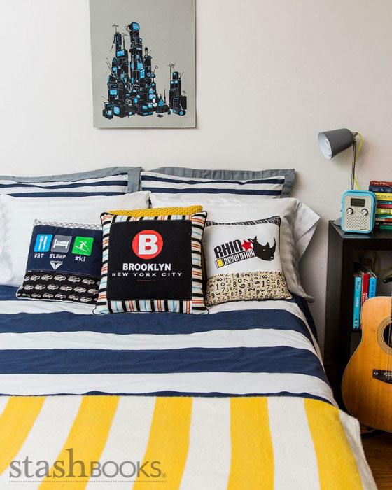 t-shirt pillows on a bed