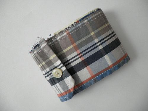 a wallet made from a shirt sleeve cuff