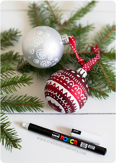 Christmas ornaments decorated with pen drawings and designs