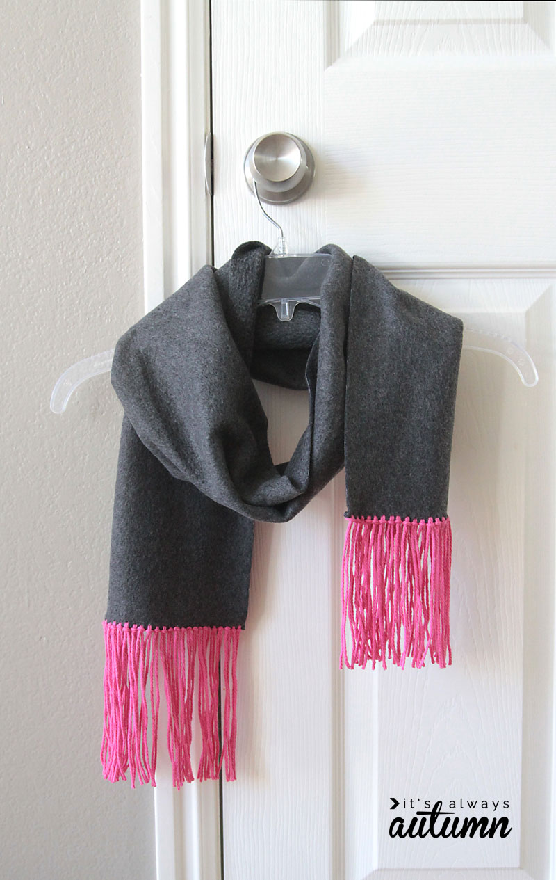 A no sew scarf with fringe on a hanger