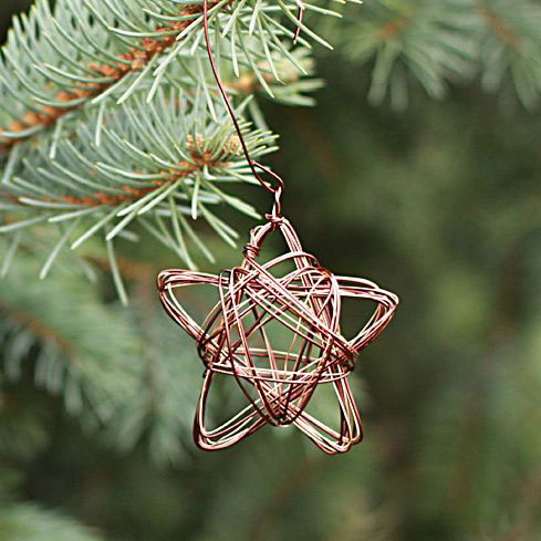 DIY wire star ornament hanging on a Christmas tree