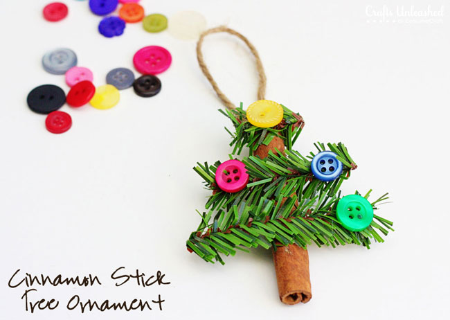 Christmas tree ornament made from cinnamon stick, pine needles and buttons