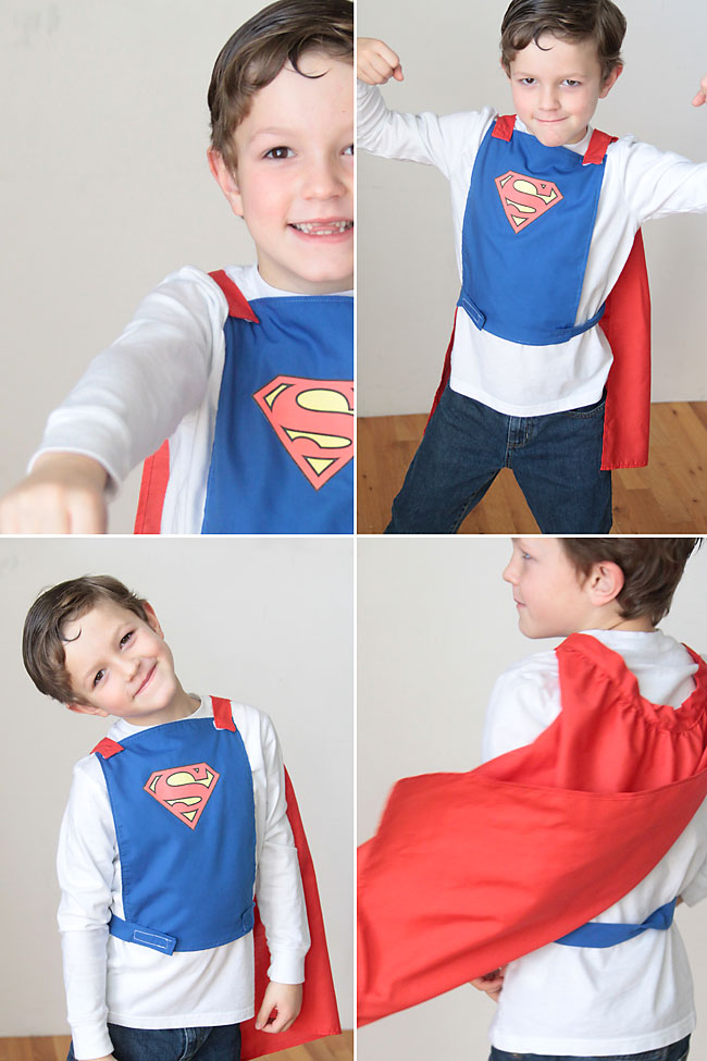 A young boy playing in a homemade superhero cape