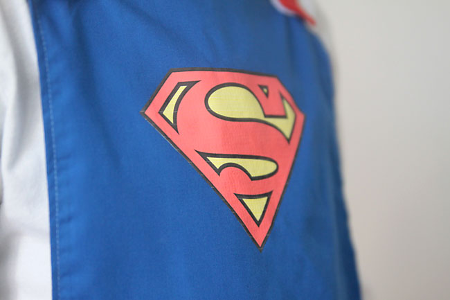 superman logo on a blue cape
