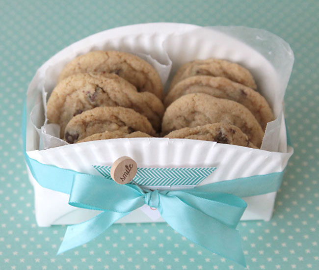 cookie basket made from a folded paper plate tied with ribbon
