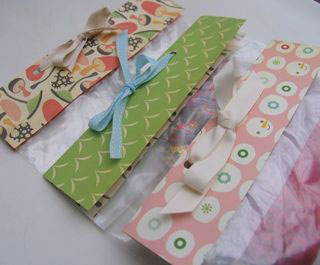ziplock bags topped with pretty paper and ribbon
