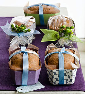 mini loaves of bread in cute paper containers tied with ribbon