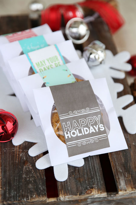 CD envelopes with a cookie inside each and a happy holidays tag