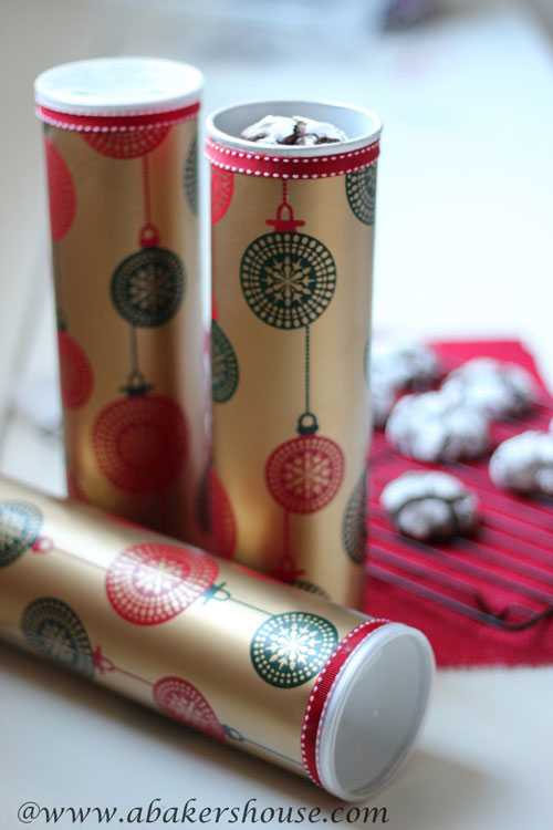 pringles containers wrapped in christmas paper to hold cookies