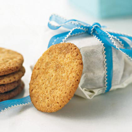 stack of cookies tied up in wax paper tied with a blue ribbon